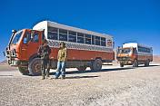 Two Dragoman Overland trucks and their drivers.