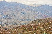 Many houses packed into the valley and slopes of the bowl of La Paz.