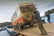 Loading a Dragoman Overland truck on to a barge to cross the Estrecho de Tiquina on Lake Titicaca.