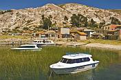 Boats moored in harbor on the Isla del Sol in Lake Titicaca.