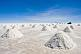 Jeep stops to view piles of salt ready for collection at the Uyuni Salt Flats.