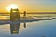 Man with Land Rover viewing the sunset on the Uyuni Salt Flats.
