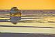 Toyota 4WD crossing the Uyuni Salt Flats at sunset.