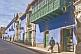 Image of Man walks past the Hostal Las Tres Portadas on Calle Bolivar.