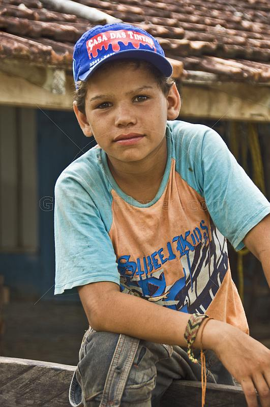 Young Brazillian cowboy in teeshirt and hat.