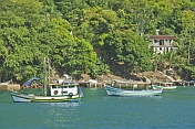 Boats at anchor in the waters of the Bahia Da Ilha Grande.