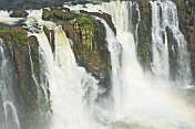 Water cascades over the rocks at the Iguazu Falls.