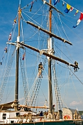 Crewmen work aloft on the rigging of the schooner 'Fair Jeanne'.
