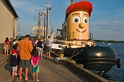Visitors to Pictou Docks wait to board for a harbour trip on the tugboat 'Theodore Too'.