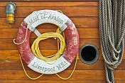 Lifebelt porthole and rope contrast the deckhouse planking on the schooner 'Mist of Avalon'.