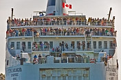 Passengers on rear decks of ferry 'C.T.M.A. Vacancier' as she prepares to depart for the mainland.