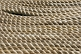 Image of Lines of white rope stacked close together.