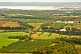 Image of Forests and apple orchards contrast rolling farmland next to the Minas Basin.