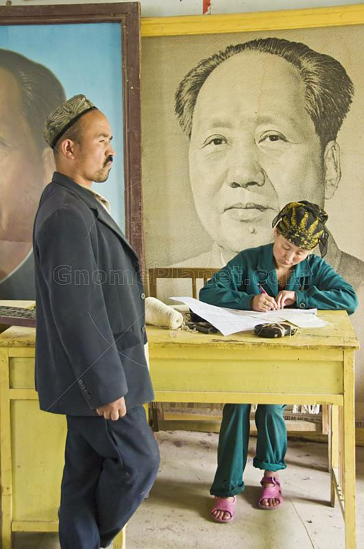 Silk workers with Chairman Mao Tsedong picture.