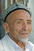 Local man with Uighur hat and gold teeth.