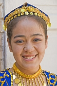 Smiling Uighur girl in local dress.