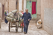 Man with donkey-cart in the twisting streets of the old city.