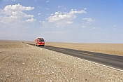 Red Chinese truck crossing the Turpan Depression.
