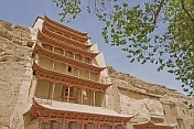 Chinese-style multi-layered roofs protect access to the Buddhist Mogao Caves.
