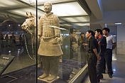 Chinese visitors admire a Terracotta Soldier and horse.