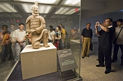 Chinese visitors admire a kneeling Terracotta Archer.