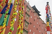 Putuozongcheng Buddhist Temple exterior with prayer flags.
