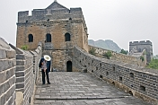 A male worker cleans weeds from the Great Wall of China.