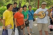 Chinese passers-by stop to join in the Sunday singing at Jingshan Park.