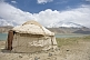 Image of A yurt next to Karakul Lake on the Karakoram Highway, with view of the snow-capped Pamir mountains.