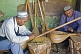 Image of Two musical instrument makers in their craft workshop.