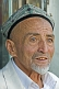 Image of Local man with Uighur hat and gold teeth.