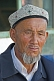 Image of Local man with Uighur hat and weather-beaten face.