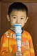 Image of Chinese boy in orange sweatshirt at the Wenmiao Temple.