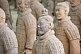 Image of Closeup of Terracotta warriors in pit number 1 show some with patches of original color.
