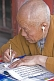 Image of Deaf monk writing at the Gao Temple.