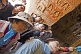 Chinese tourists visit the Yungang Buddhist caves.