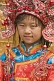 Image of Small Chinese girl poses for photograph in replica Imperial Court clothes.