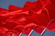 Image of Red flags billowing in the wind of Tiananmen Square.