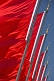 Image of Red Chinese flags for the Peoples Republic of China billowing in the wind of Tiananmen Square.
