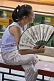 Image of Chinese girl with white paper fan in Jingshan Park.