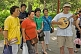 Image of Chinese passers-by stop to join in the Sunday singing at Jingshan Park.