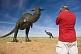 Image of Canadian tourist in red teeshirt photographing dinosaur statues near the Monolian border.