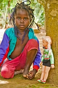 Young Congolese girl with a plastic doll.