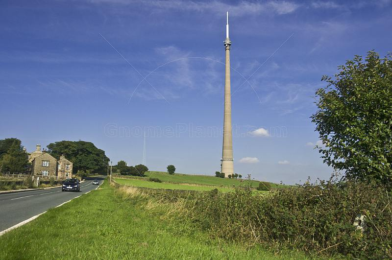 The 330m 1080 feet high Emley Moor TV transmission tower dominates nearby road and houses.