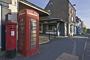 Red telephone kiosk and post box on the Market Place.