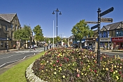Flower-filled roundabout on The Grove B6382.