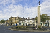 The War Memorial on a roundabout in the High Street is outside the Black Horse public house.