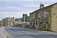 Image of Cylist passes The Postcard public house on the Huddersfield Road A6024.