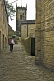 Image of Woman walks up cobbled backstreet towards Holy Trinity Church in Towngate.