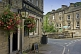 Image of Elephant and Castle public house with hanging flower baskets on Lower Mill Lane Holmfirth.